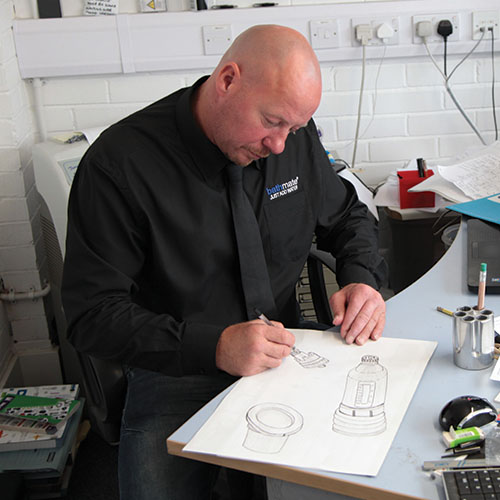 John Oakes at drawing desk