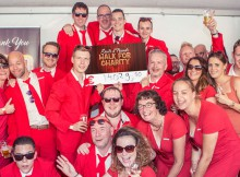 Shots team at their party with a big cheque