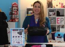 Deborah Semer of Passionate Playground holding a Joyboxx at the eroFame trade show 2015