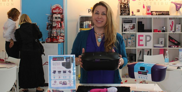 Deborah Semer of Passionate Playground holding a Joyboxx at the eroFame trade show 2015