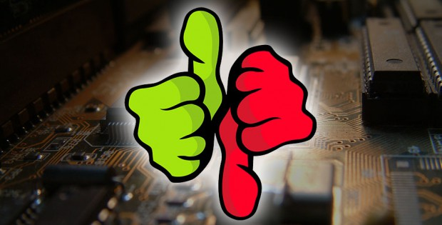 Thumbs up and down in front of a motherboard