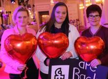 Three women with hartshaped baloons