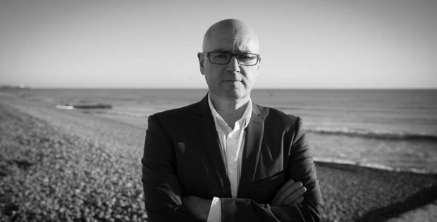 Jason Maskell in front of the sea
